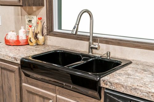 Kitchen-in-THE ANNIVERSARY 2.1-at-Freedom Homes-Carencro-in-Carencro