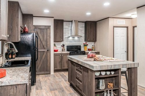 Kitchen-in-THE ANNIVERSARY 2.1-at-Oakwood Homes-Austin-in-Austin