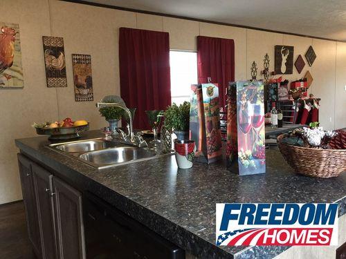 Kitchen-in-THE BREEZE-at-Freedom Homes-Lufkin-in-Lufkin