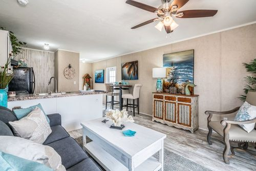 Greatroom-and-Dining-in-THE EXTRA POINT-at-Freedom Homes-Covington-in-Covington