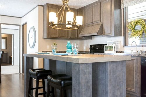 Kitchen-in-REVOLUTION 76B-at-Freedom Homes-Carencro-in-Carencro