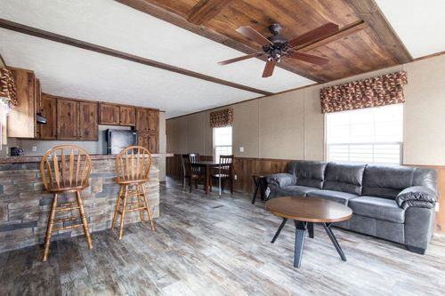 Greatroom-and-Dining-in-THE END ZONE-at-Freedom Homes-Milton-in-Milton