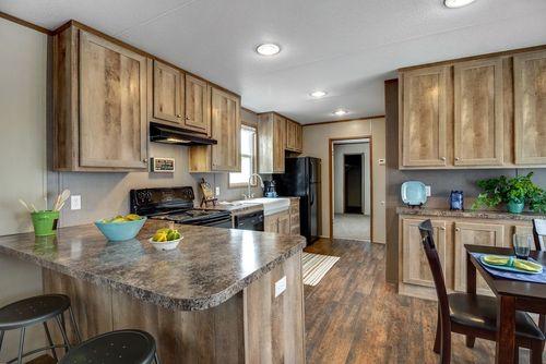 Kitchen-in-ANNIVERSARY 16763A-at-Clayton Homes-Abilene-in-Abilene