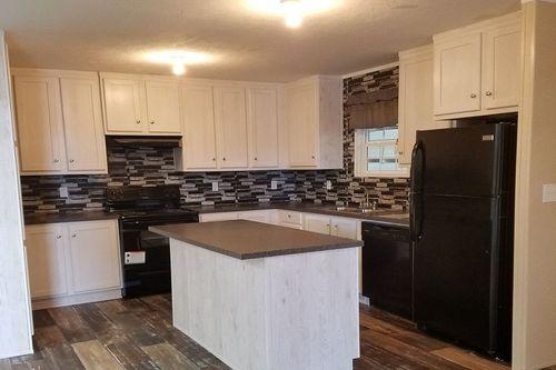 "Kitchen-in-NOW28683B ""NOW""-at-Oakwood Homes-Fletcher-in-Fletcher"