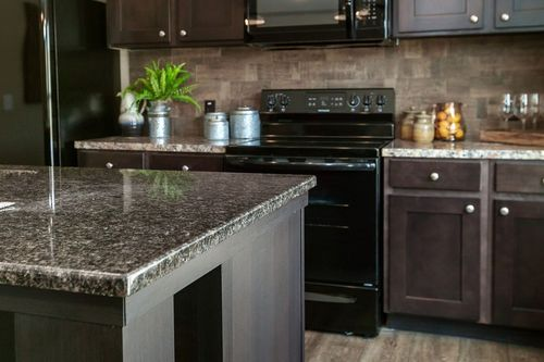 Kitchen-in-THE FRANKLIN-at-Freedom Homes-Opelika-in-Opelika
