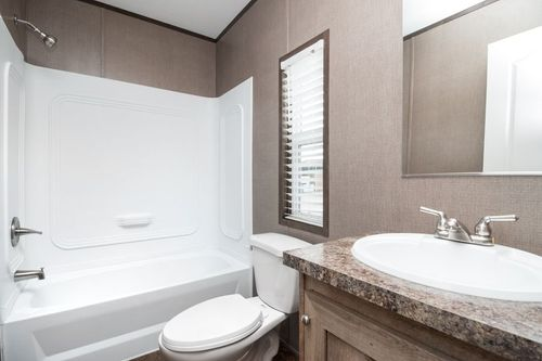 Bathroom-in-ANNIVERSARY 16682A-at-Luv Homes-Pinehurst-in-Pinehurst