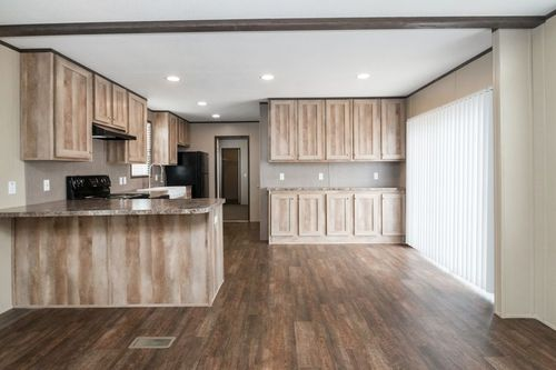 Kitchen-in-ANNIVERSARY 16682A-at-Luv Homes-Pinehurst-in-Pinehurst