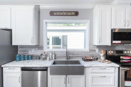 Kitchen-in-THE TALLAHASSEE-at-Oakwood Homes-San Antonio-in-San Antonio