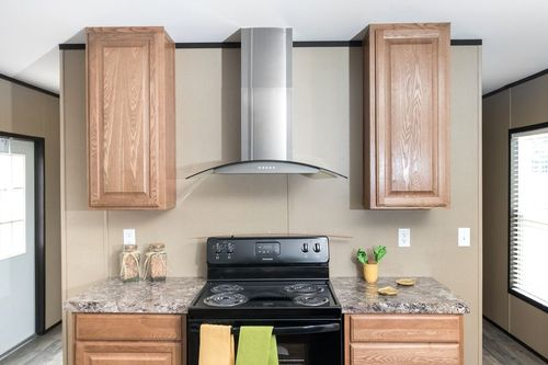 Kitchen-in-THE BREEZE HD-at-Freedom Homes-Sherman-in-Sherman