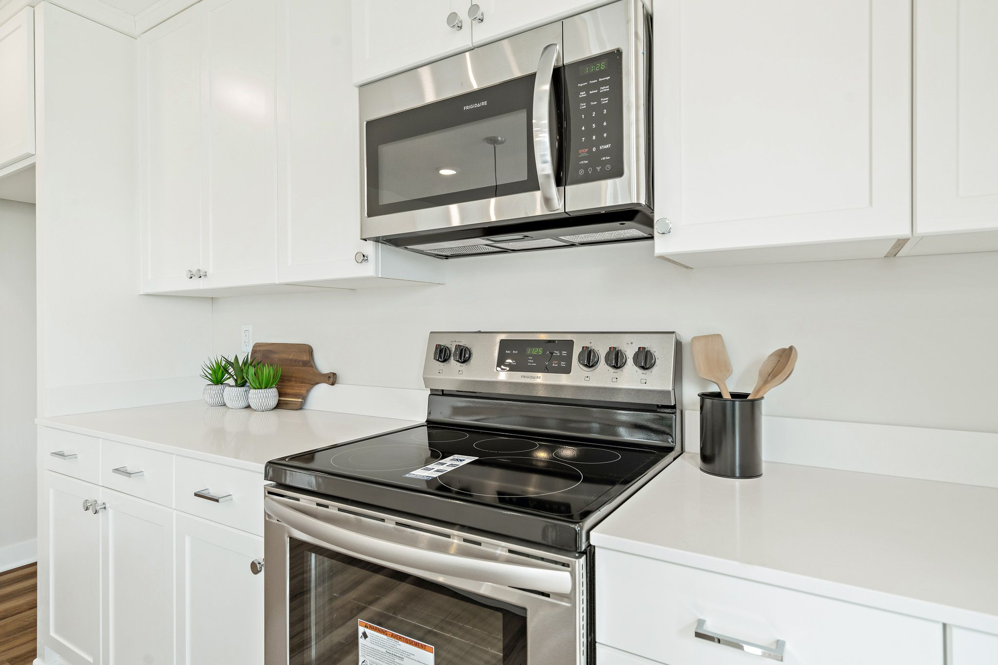 Kitchen featured in the indigo By clover & hive in Kansas City, MO