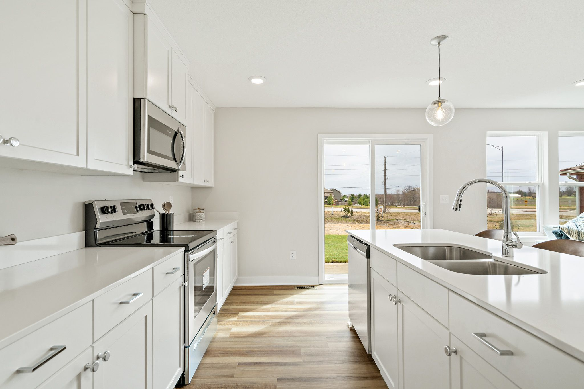 Kitchen featured in the indigo - contemporary By clover & hive in Kansas City, MO