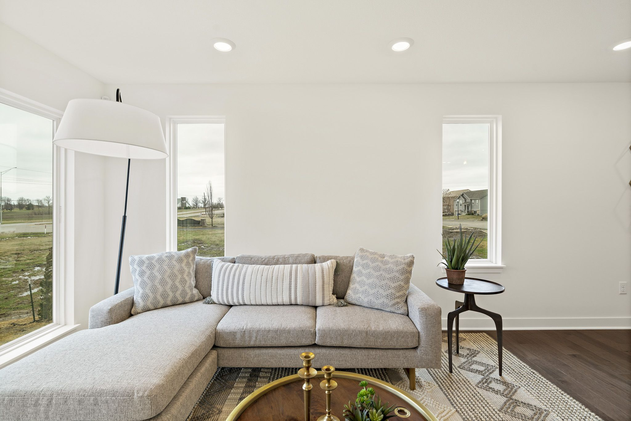 Living Area featured in the sapphire - contemporary By clover & hive in Kansas City, MO