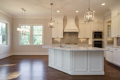 Kitchen-in-The Abbington II - Legacy Custom Homes-at-Stillwater-in-Apex