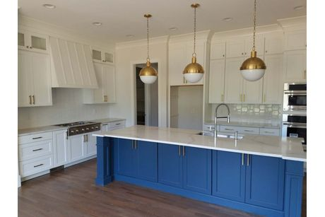 Kitchen-in-Oakwood II-Legacy Custom Homes-at-Stillwater-in-Apex