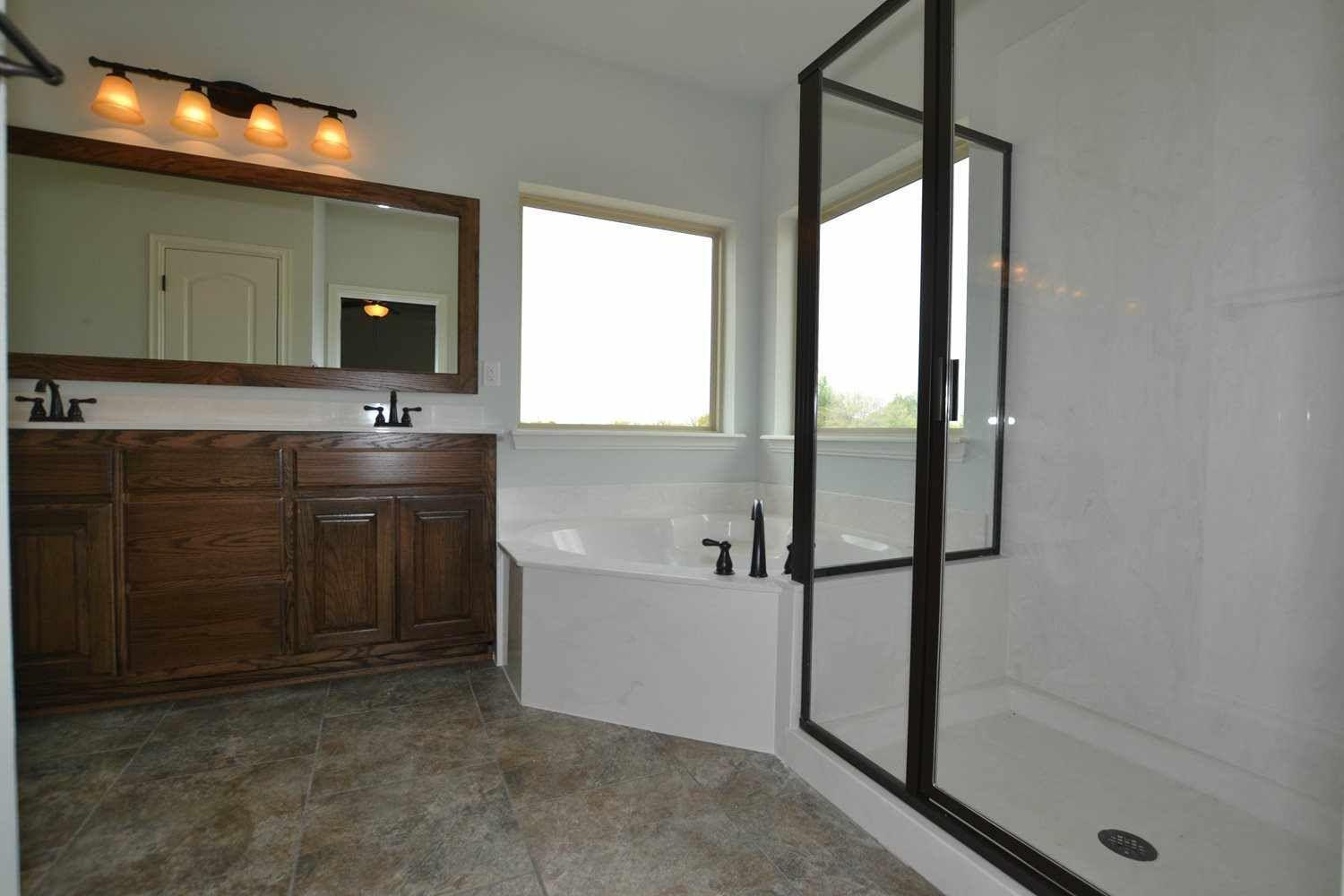 Bathroom featured in the Woodland IV By Concept Builders, Inc in Tulsa, OK