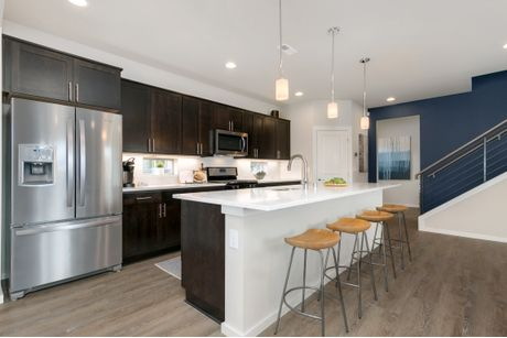 Kitchen-in-Residence 3-at-Conner Homes at Ten Trails-in-Black Diamond