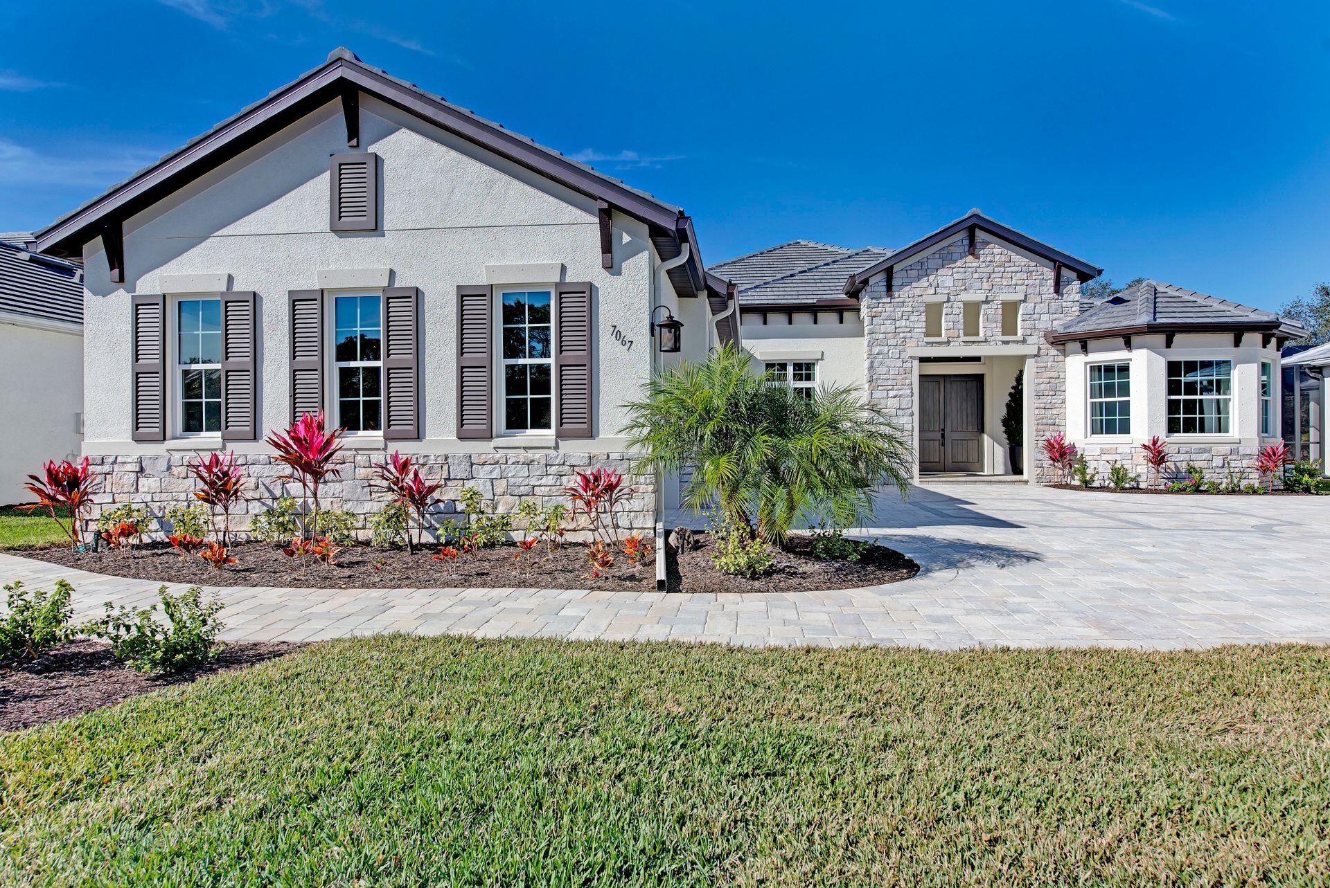 Exterior featured in the Santa Maria By Medallion Home in Sarasota-Bradenton, FL