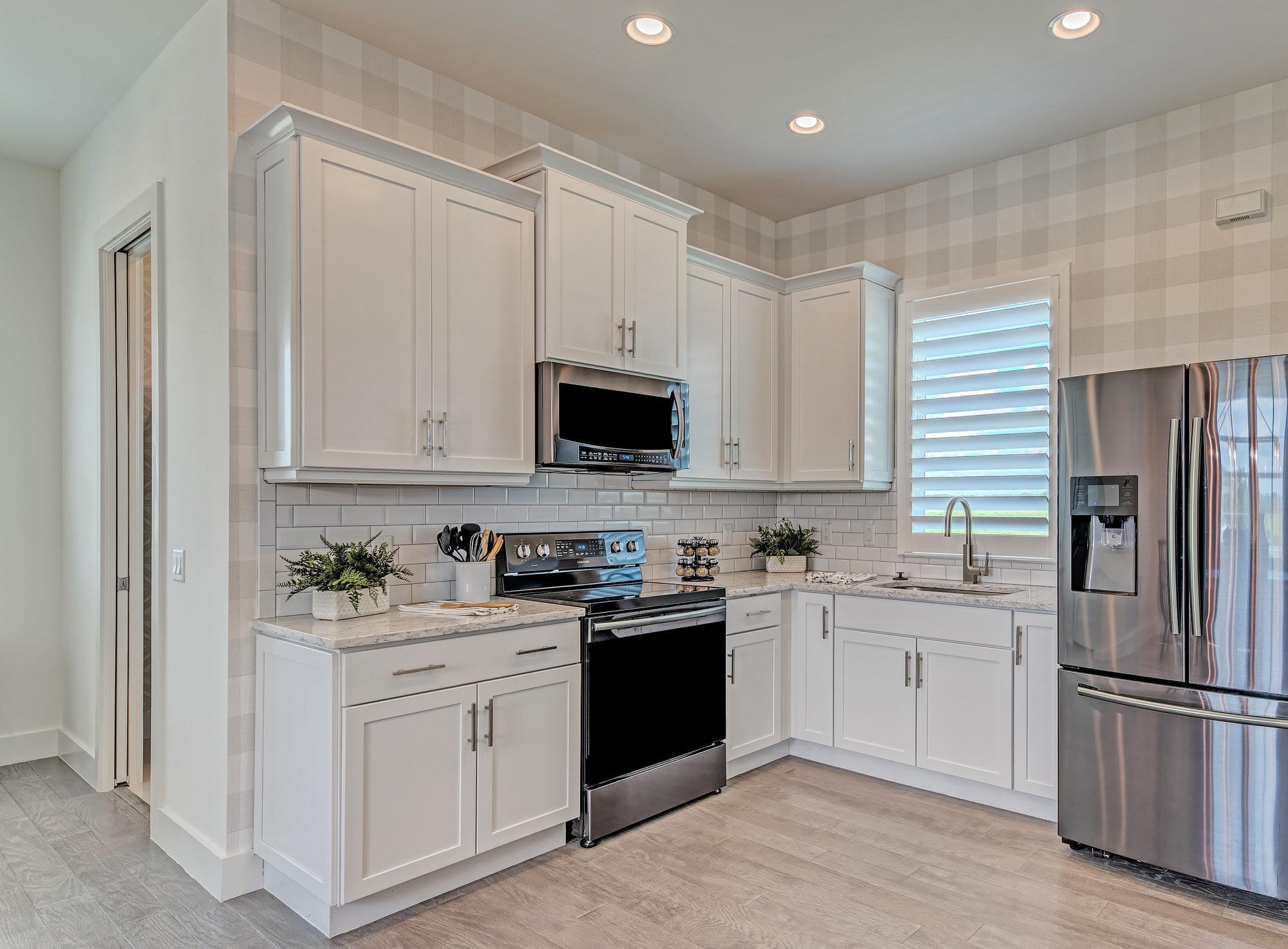 Kitchen featured in the Barbados 2800 3 Car Garage By Medallion Home in Sarasota-Bradenton, FL