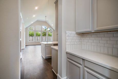 Kitchen-in-Design 5863-at-Timarron Lakes in Creekside Park West-in-The Woodlands