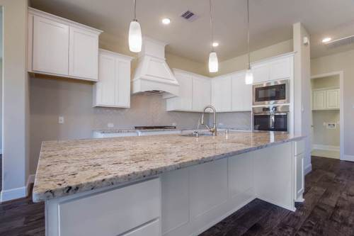 Kitchen-in-Design 7312-at-Avalon at Spring Green 75'-in-Katy