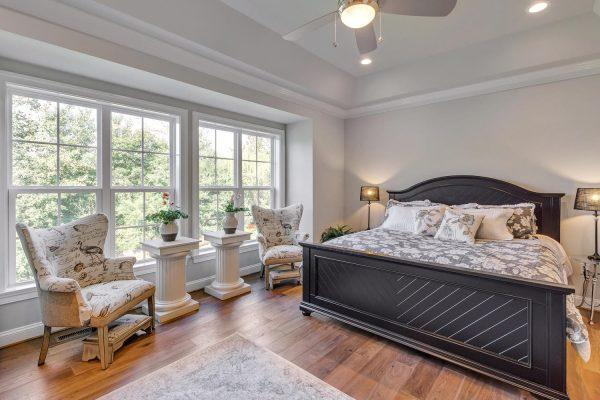 Bedroom featured in the Greenside Villa By Craig Builders in Charlottesville, VA