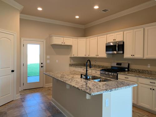Kitchen-in-Canna III A-at-The Settlement at Live Oak-in-Thibodaux