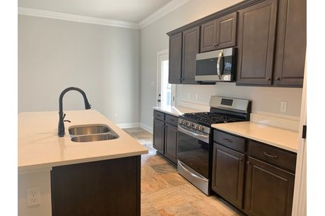 Kitchen-in-Oleander IV A-at-The Settlement at Live Oak-in-Thibodaux