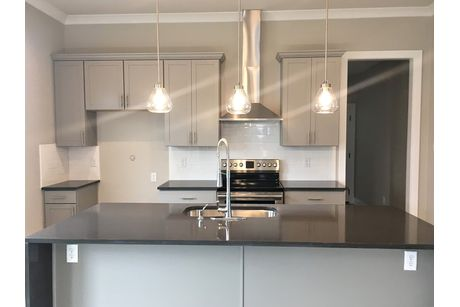 Kitchen-in-Toledo III A - Modern-at-The Village at Morganfield-in-Lake Charles