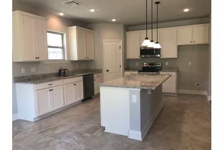 Kitchen-in-Camellia IV B-at-Talla Pointe-in-Ocean Springs