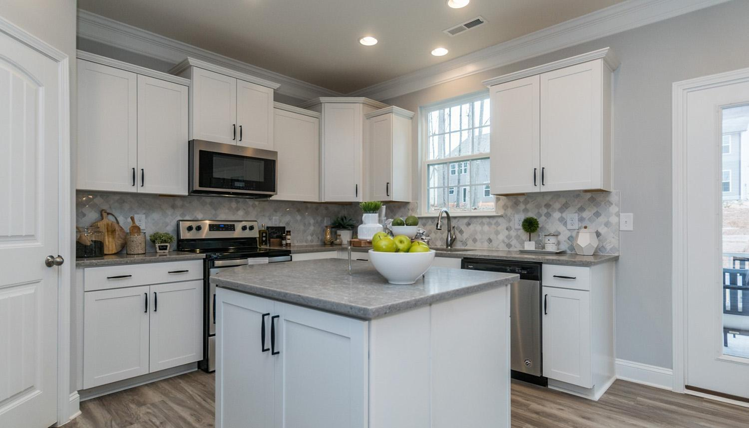 Kitchen featured in the Devon By Dan Ryan Builders in Raleigh-Durham-Chapel Hill, NC