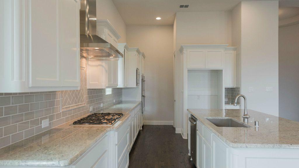 Kitchen-in-5031 Plan-at-Montgomery Farm Estates - 62' Homesites-in-Allen