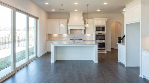 Kitchen-in-1025 Plan-at-Montgomery Farm Angel Field East - 31' Homesites-in-Allen