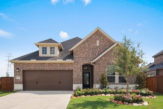 Exterior:You will love pulling up to the attractive brick and stone exterior and into your 3 car garage!  The