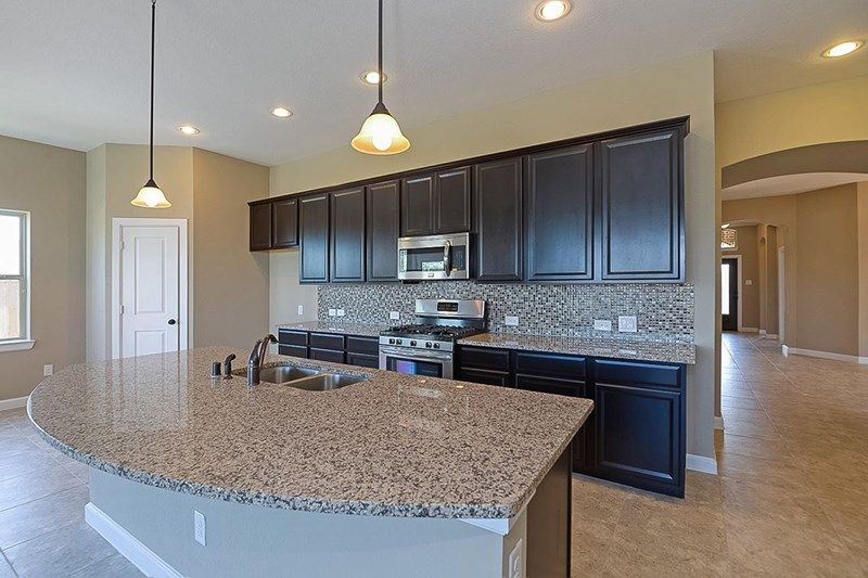 Kitchen-in-Queenfield-at-Cane Island - Elmwood Trails-in-Katy