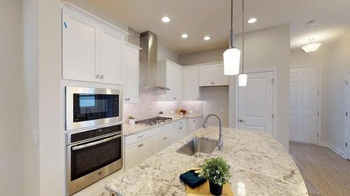 Kitchen-in-Starstone-at-Griffin Park - Bungalow Series-in-Lake Mary