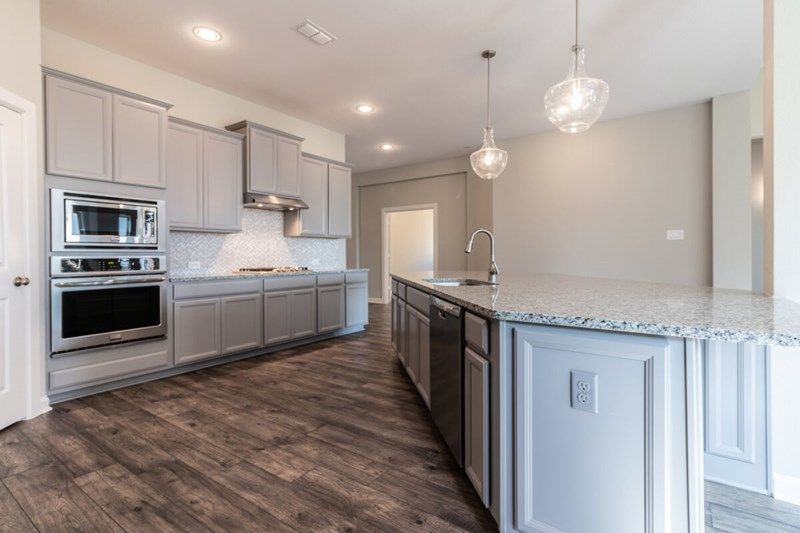 Kitchen-in-Hillhaven-at-Lakes at Creekside 55'-in-Tomball