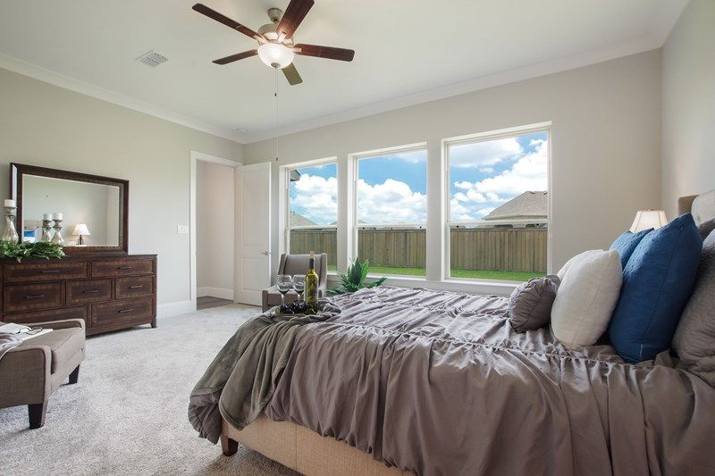 Bedroom featured in the Aubergine By David Weekley Homes in Houston, TX