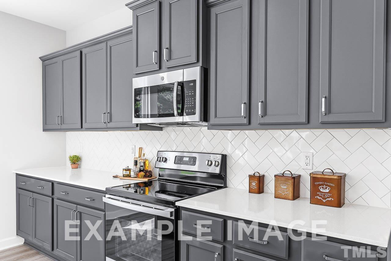 Kitchen featured in The Chestnut By Davidson Homes LLC in Raleigh-Durham-Chapel Hill, NC