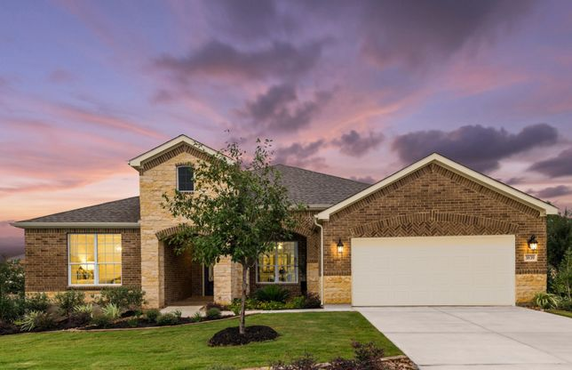 Magnolia:The Magnolia, a one-story home with 2-car garage, shown with Home Exterior D