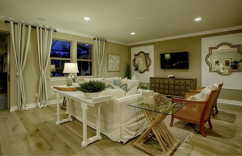 Greatroom-and-Dining-in-Tangerly Oak-at-Del Webb Stone Creek-in-Ocala