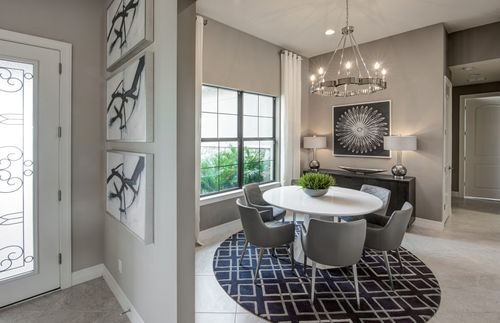 Dining-in-Tangerly Oak-at-Winding Cypress-in-Naples