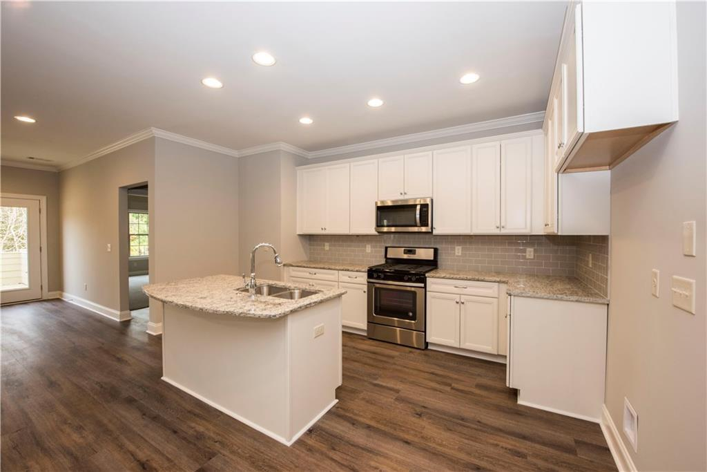 Kitchen featured in The Palmetto 11C Plan By Dilworth Development  in Auburn-Opelika, AL