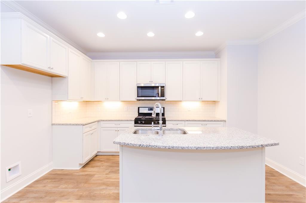 Kitchen featured in The Palmetto 9A Plan By Dilworth Development  in Auburn-Opelika, AL