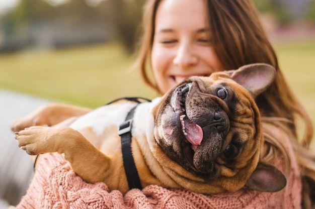 woman-holding-dog