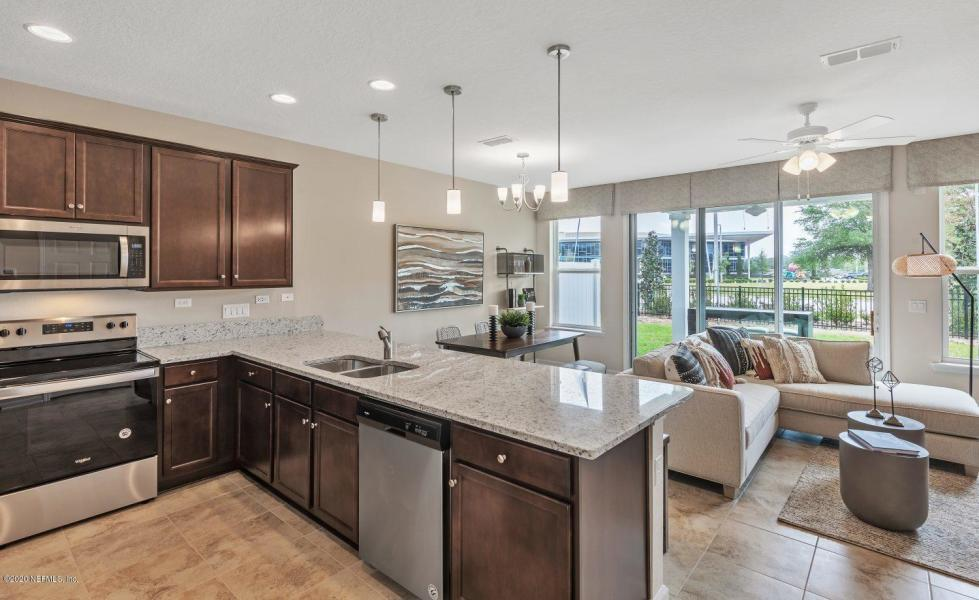 Kitchen featured in the Warbler By Dream Finders Homes in Jacksonville-St. Augustine, FL