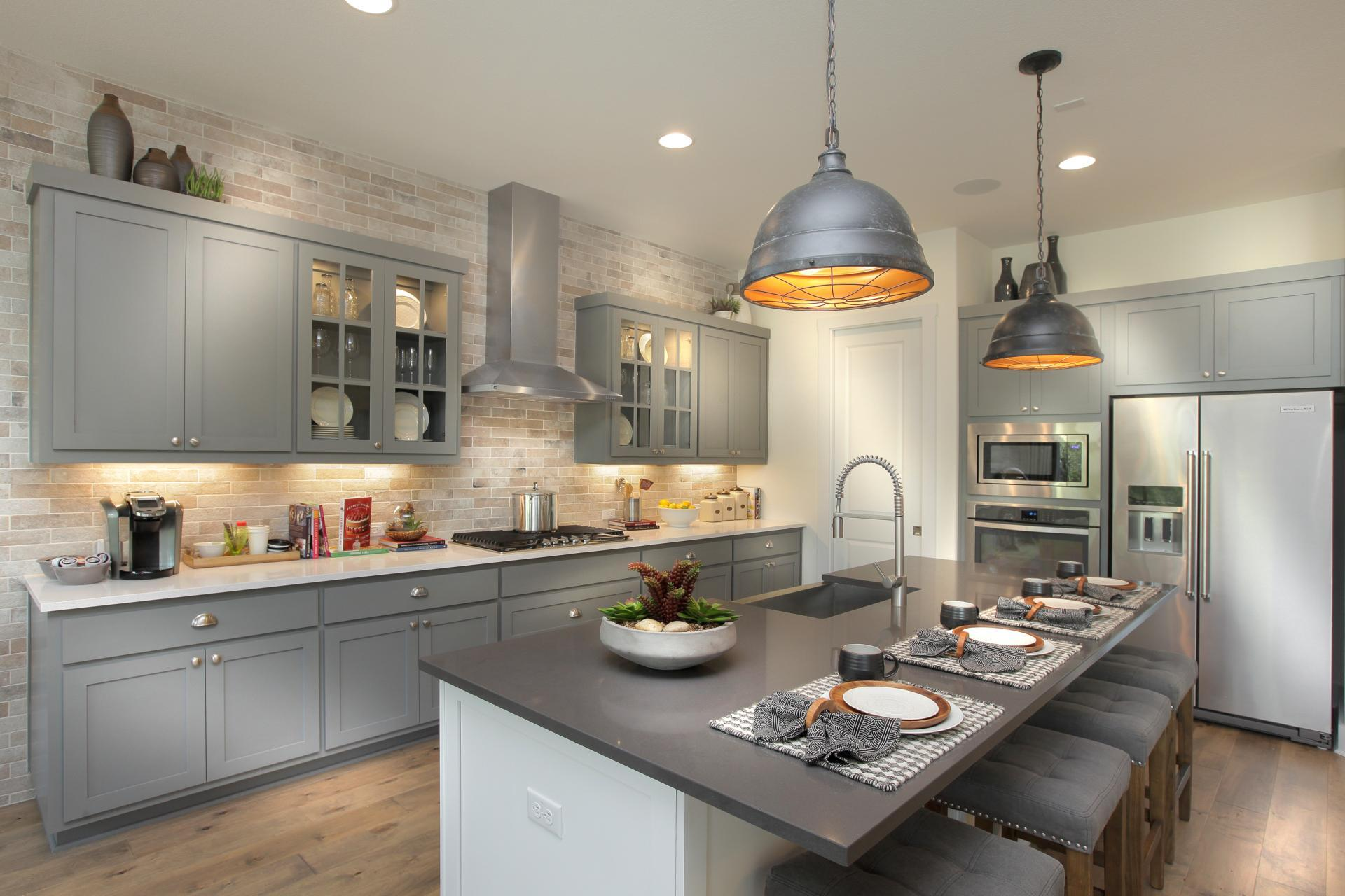 Kitchen featured in the Sumlin By Drees Custom Homes in Dallas, TX