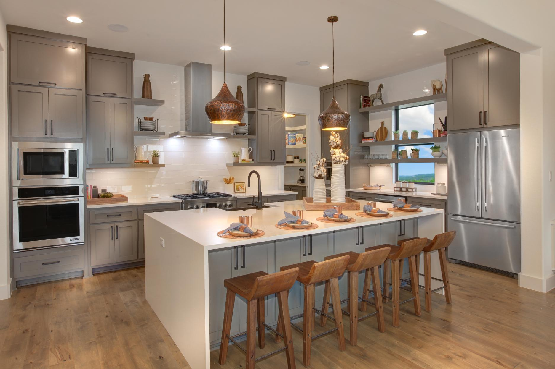 Kitchen featured in the Grantley By Drees Custom Homes in Austin, TX