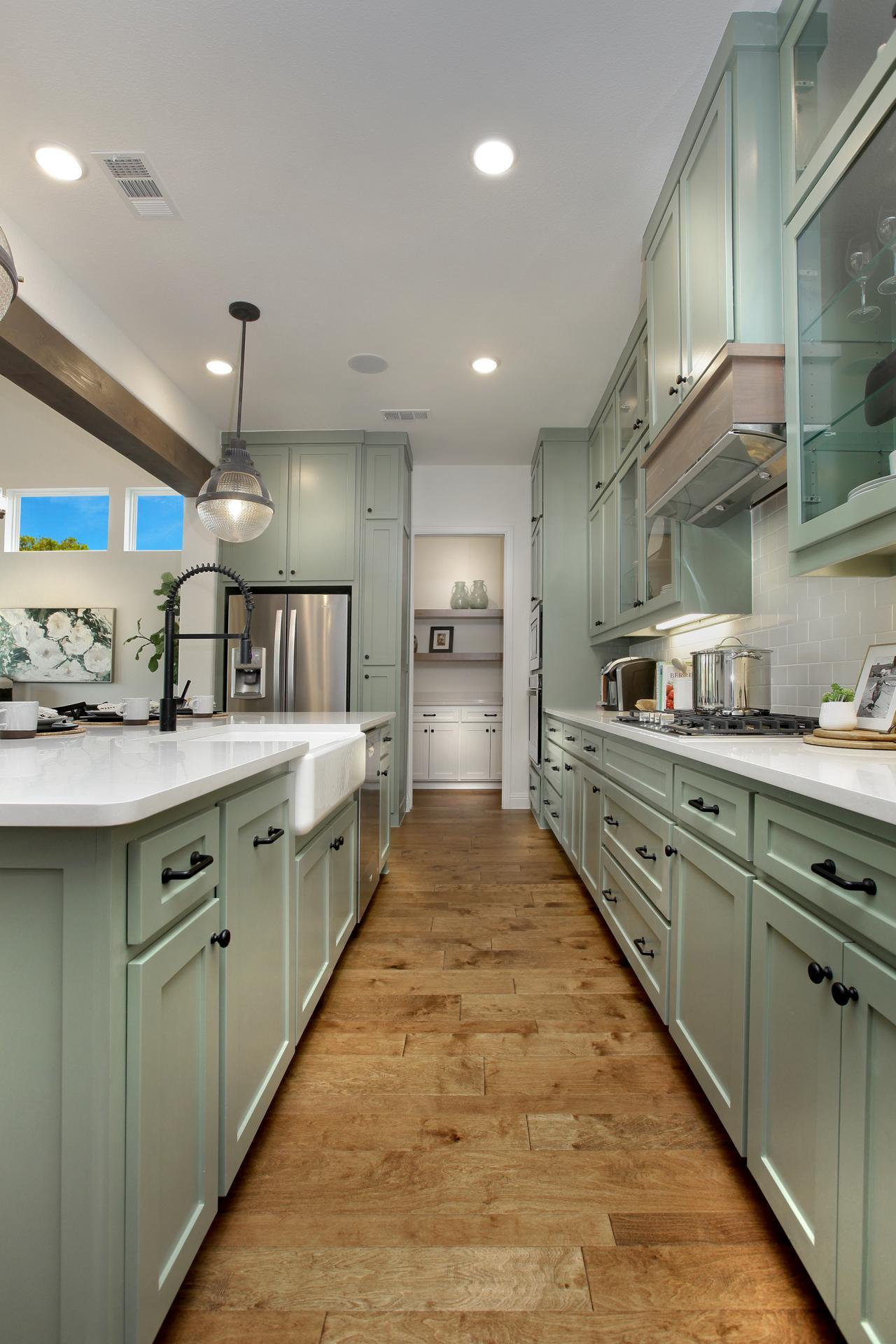 Kitchen featured in the Brynlee By Drees Custom Homes in Austin, TX