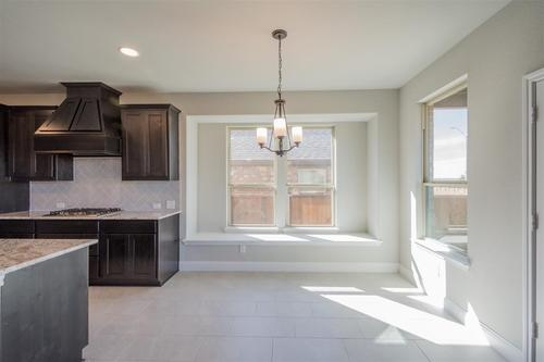 Kitchen-in-Camelot-at-Lakeside Estates at Paloma Creek-in-Little Elm