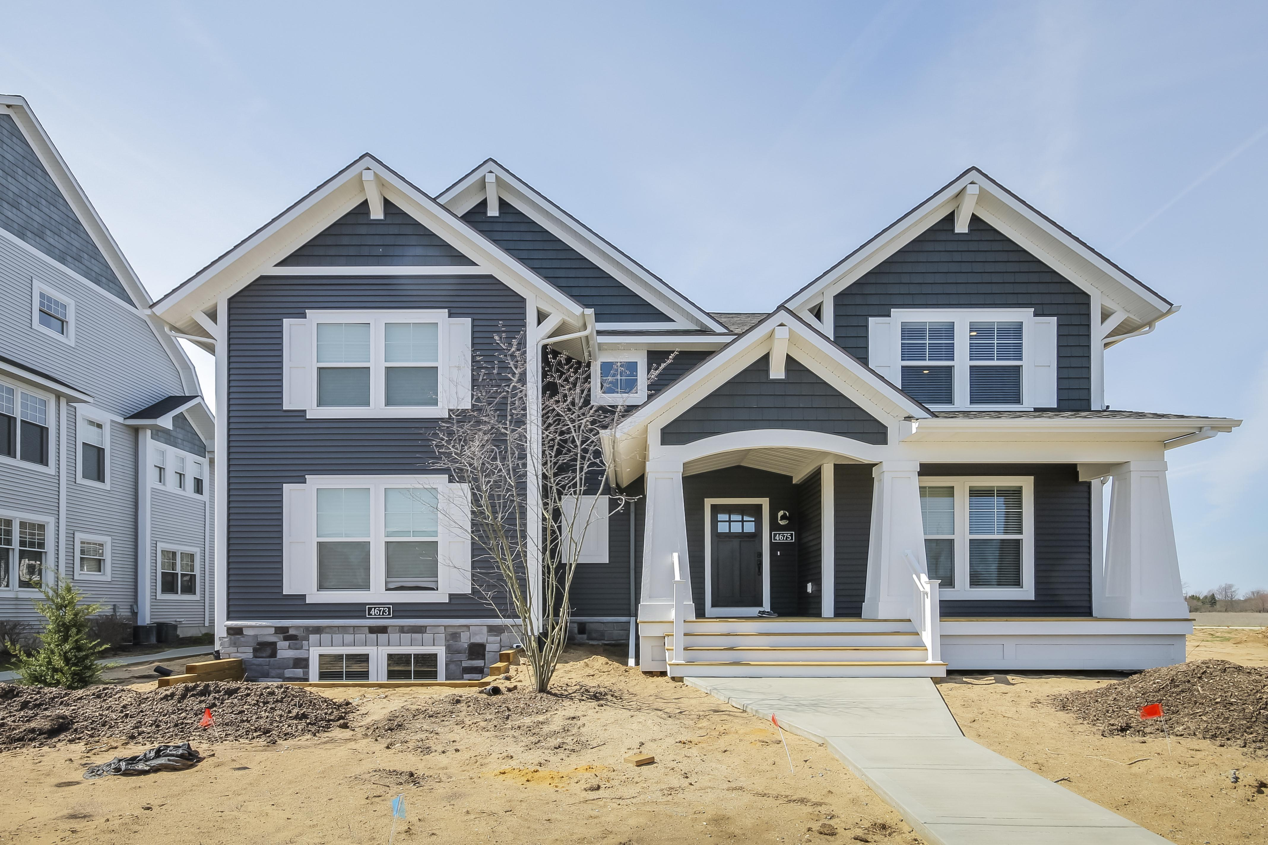 Exterior featured in The Macatawa Legends Townhomes By Eastbrook Homes Inc. in Grand Rapids, MI